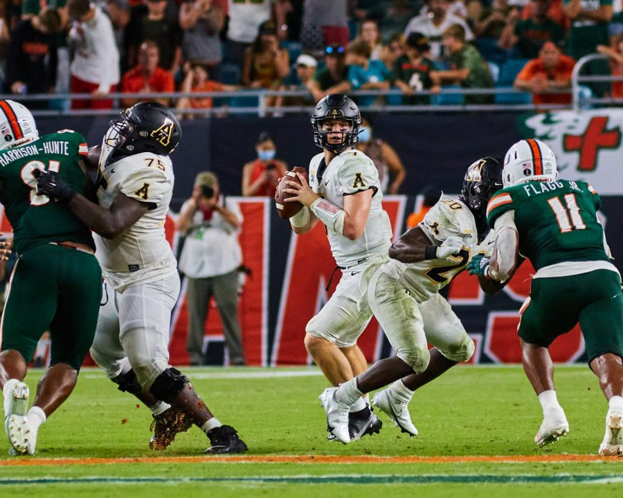 Chase Brice drops back to pass during a late-game drive against No. 22 Miami. Brice finished 21/34 passing for 199 yards and one touchdown in a heartbreaking loss at Hard Rock Stadium.