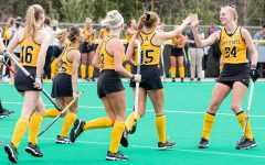 Midfielder Veerle Van Heertum (right, #24) high fives forward Rachel Fleig (left, #15) in App State's spring matchup with Ball State. The Mountaineers defeated the Cardinals 1-0 after Fleig's deciding goal in the 29th minute.