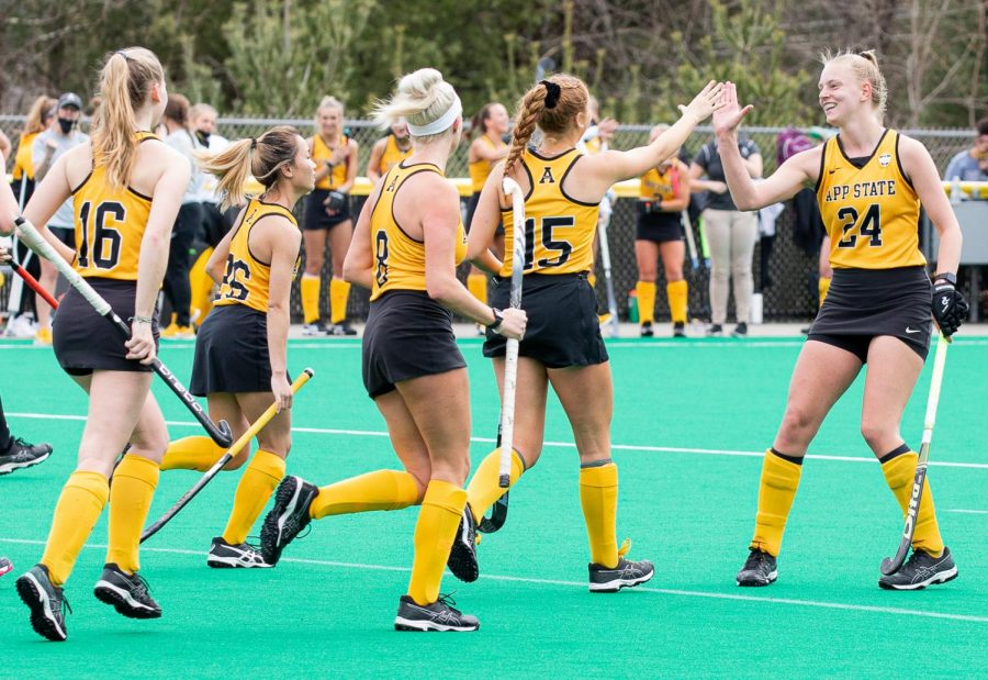 Midfielder+Veerle+Van+Heertum+%28right%2C+%2324%29+high+fives+forward+Rachel+Fleig+%28left%2C+%2315%29+in+App+States+spring+matchup+with+Ball+State.+The+Mountaineers+defeated+the+Cardinals+1-0+after+Fleigs+deciding+goal+in+the+29th+minute.+