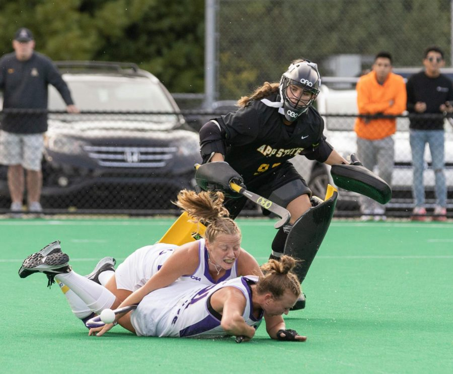 Junior goalkeeper Addie Clark watches as two JMU players collide and collapse to the ground. Clark made eight saves against JMU and 10 saves in the Sept. 12 matchup with OSU.