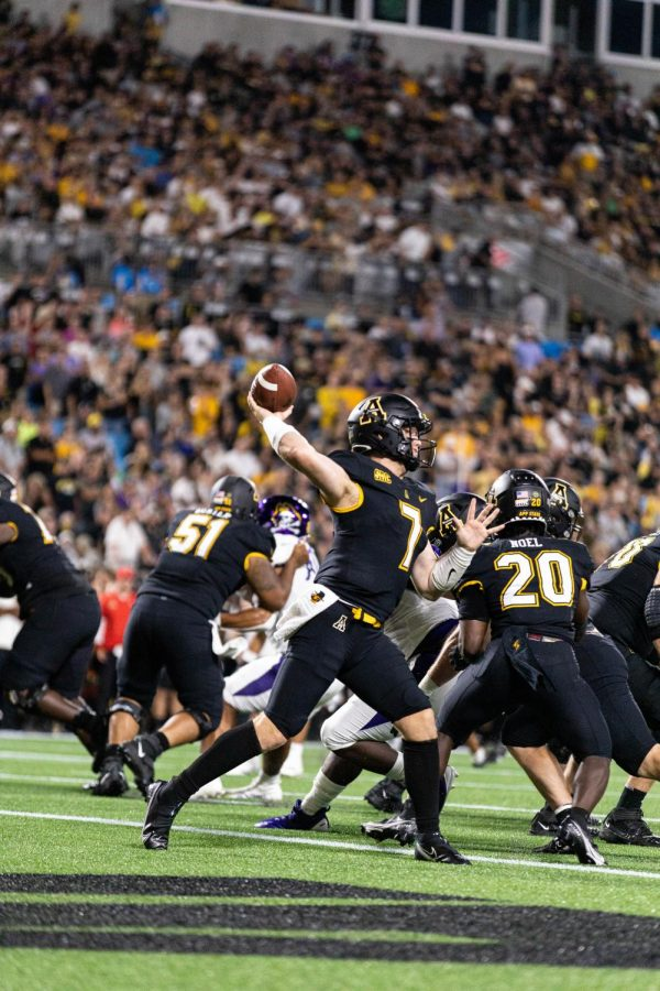 Graduate transfer Chase Brice unloads from the pocket in his Mountaineer debut. Brice completed 20 of his 27 pass attempts in the season opener, good for 259 yards and a pair of touchdowns.