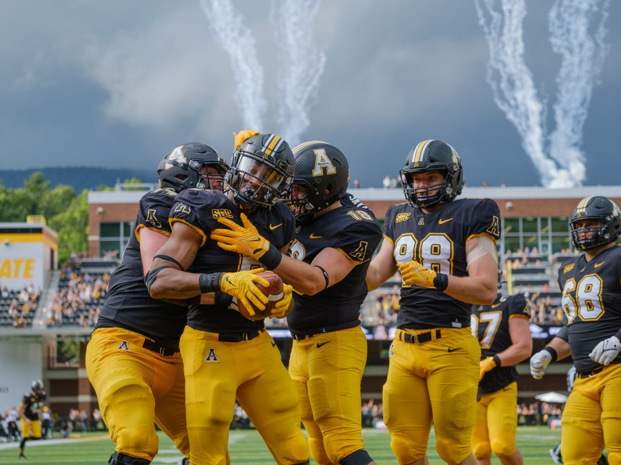 Junior running back Cam Peoples celebrates his second touchdown of the day with his offensive line. Peoples found the end zone twice on 11 carries in the 2021 home opener vs Elon.