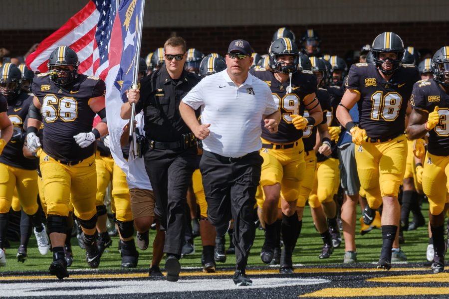 Shawn Clark leads his team out of the new north end zone facility for the first time in App States home-opening matchup with Elon. The Mountaineers went on to throttle the Phoenix 44-10, moving to 2-1 on the season.