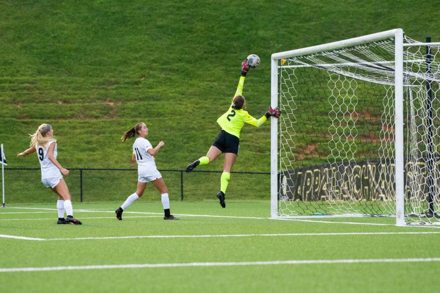 Junior goalkeeper Kerry Eagleston secures one of her 20 saves on the night. Those 20 saves tied her own personal best, one short of the single game school record, held by Kelley Guinn who recorded 21 saves in 1995.