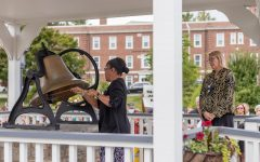 """Lynn Patterson, class of '89 alumna, rings the bell. Patterson is a Belk Library university program specialist and daughter of fellow Bell Ringer Roberta Jackson. Karl Campbell, the event's leading speaker, said Patterson represented """"the service of faculty and staff to App State and the many multi-cultural mountaineers, multi-generational families."""""""