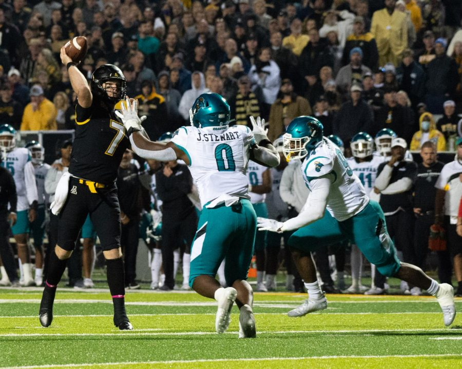 Graduate transfer quarterback Chase Brice let's the ball fly with two Chanticleers in his face. Brice posted 347 passing yards and two touchdowns against a defense only giving up 15 points per game.
