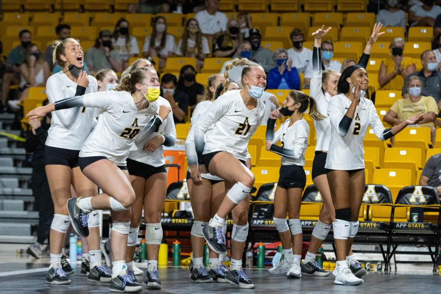 App State volleyball celebrates its season-opening victory over Eastern Kentucky. The Mountaineers eliminated the Colonels in five sets and finished the Appalachian Invitational 2-1.