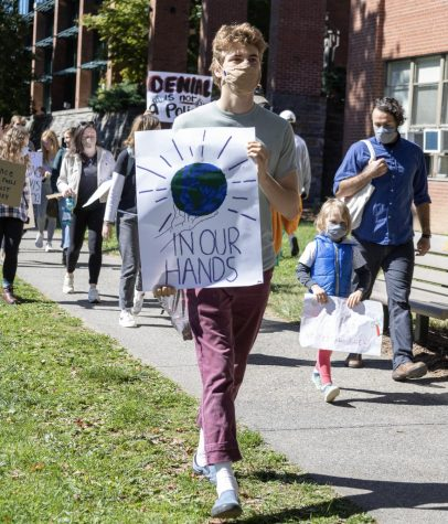 ClimACT and its supporters marched across campus Sept. 24 after attending the board of trustees meeting that day to demand climate action.