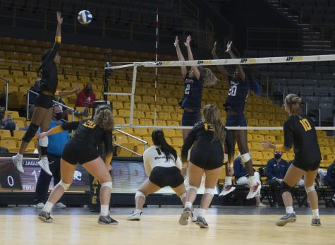 Senior outside hitter Victoria Wilform rises up to spike the ball over the net. Wilform finished the match against South Alabama with seven kills and three digs.
