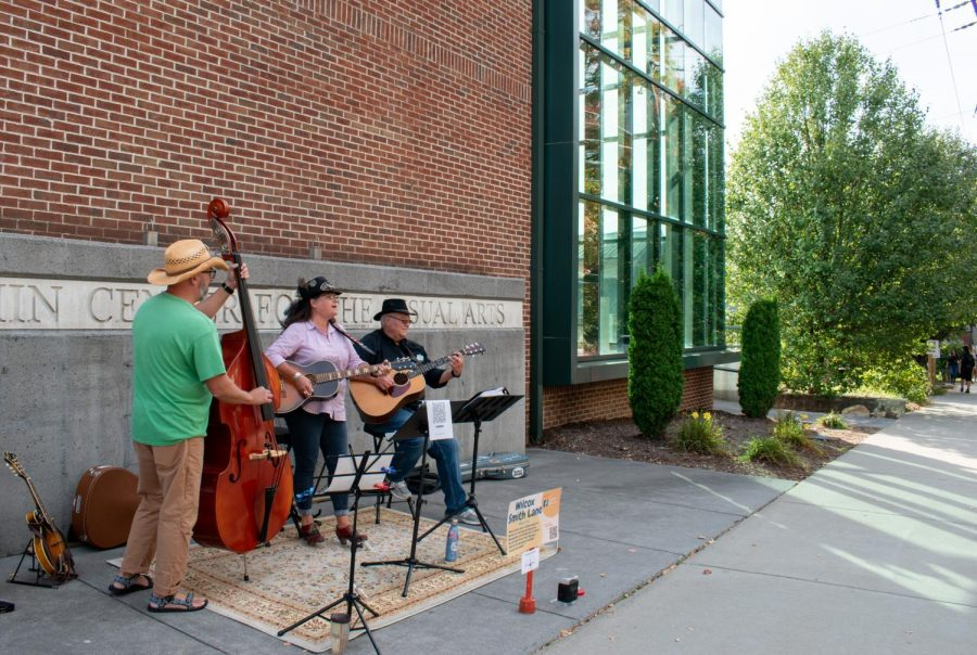Boone-based trio Wilcox Smith Lane performs outside of the Turchin Center.
