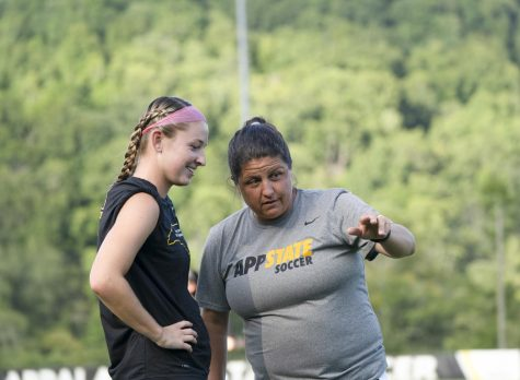 Women's soccer head coach Sarah Strickland coaches junior forward  Hayley Boyles ahead of their 2-1 win against the University of South Carolina Upstate. Strickland has led her squad to a 4-6-1 start to the 2021 season.