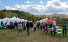 """Crowds gather in a field across from Holy Cross Episcopal Church to enjoy vendors, food, and mountain music at the Valle Country Fair on Saturday in Valle Crucis. The Holy Cross Episcopal Church hosted the fair starting in 1979 and host it every third Saturday of October. Vendors are asked to """"tithe"""" 10% of their proceeds to go toward serving nonprofits in the High Country."""