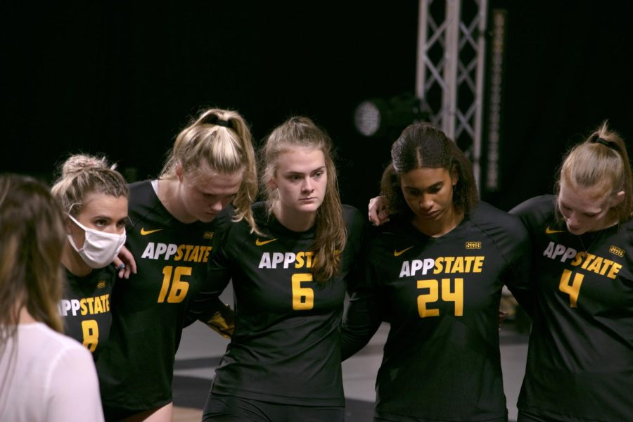 Freshman middle hitter Lauren Pledger huddles up with her team en route to a 3-1 victory. Pledger saw her first action of the season against ULM.