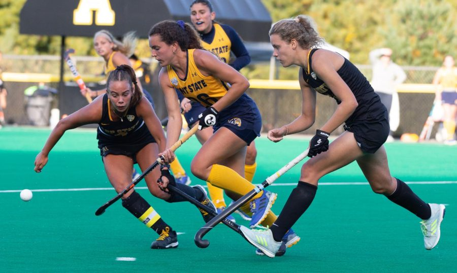 Senior midfielders Anna Smarrelli and Friederike Stegen challenge a Kent State attack by Clara Rodriguez Seto. The Mountaineers struggled to contain Rodriguez Seto as she scored both goals in the 2-1 victory for the No. 22 Golden Flashes.