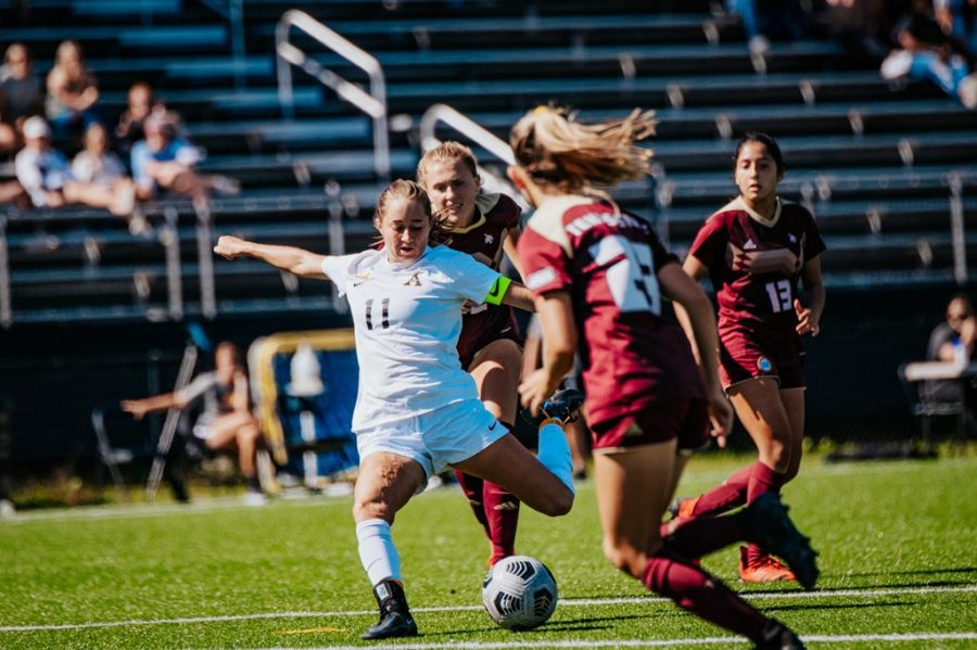 Junior defender Olivia Cohen strikes the ball away from three Bobcat attackers. Cohen has started all 13 matches for the Mountaineers this season.