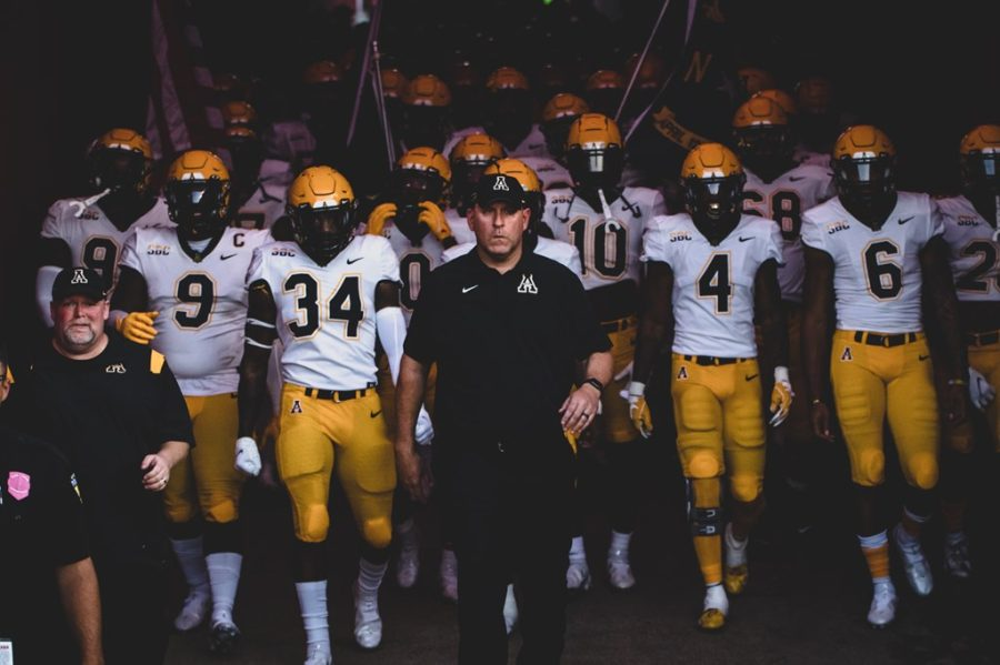 Head coach Shawn Clark leads the Mountaineers onto the field in their conference matchup with Louisiana. Clark is now 0-2 against the Ragin' Cajuns, the only two losses to Louisiana in program history, and sits at 0-1 against Coastal Carolina, the program's only loss to the Chanticleers.