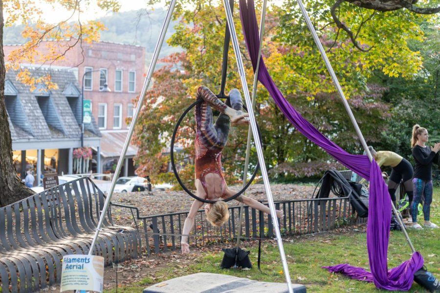 Caitlyn Byrd, aerialist and founding member of Inspiral Fire Tribe, performs in front of Jones House as part of the Filaments Aerial Collective. Inspiral Fire Tribe was also present on the lawn for community attendees of Buskers Fest to watch.